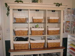 My curio with baskets