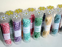 SRM tubes for twine storage