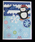 Penguin card with snowflakes in blue