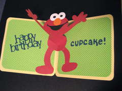 Elmo's Party Birthday Card inside.