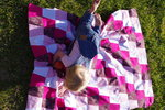 Ally on Piper's quilt top