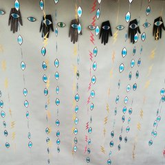 Evil Eyes and Lightening bolt sewn paper decorations